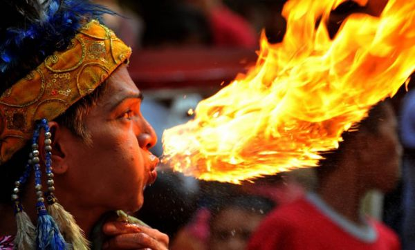 A fire breather performs in Chinatown in Manila a day before the Chinese New Year on January 22, 2012. The Lunar New Year falls on January 23 and is the begining of the Spring Festival holiday. AFP PHOTO/NOEL CELIS